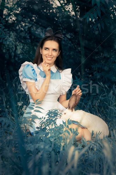 Nina mundo maravilloso blanco conejo retrato sonriendo Foto stock © NicoletaIonescu