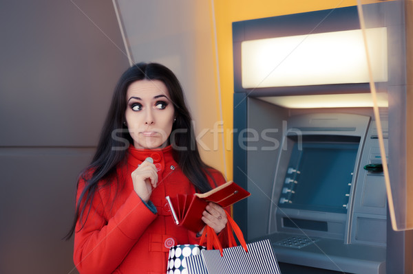 Funny Shopping Woman Holding a Penny in front of an ATM Stock photo © NicoletaIonescu
