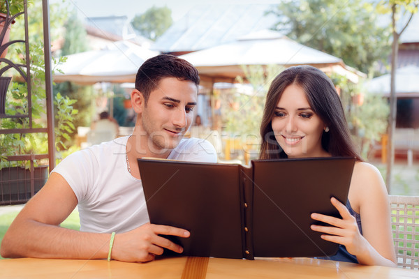 Romantic Couple on a Date Holding Restaurant Menu  Stock photo © NicoletaIonescu