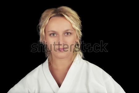Fiatal karate nő kimonó közelkép portré Stock fotó © NicoletaIonescu