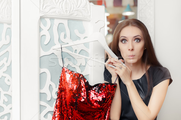 Astonished Girl Trying on Red Party Dress in Dressing Room Stock photo © NicoletaIonescu