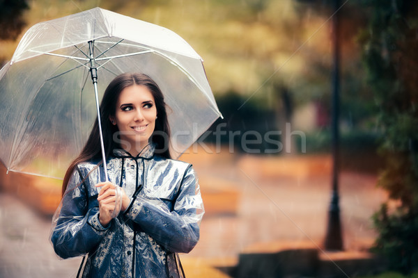 осень женщину прозрачный плащ зонтик красивая девушка Сток-фото © NicoletaIonescu