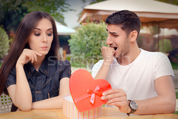 Nervous Boyfriend presenting his Gift to his Picky Girlfriend Stock photo © NicoletaIonescu