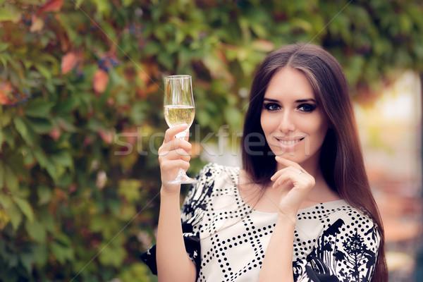 Gyönyörű nő tart pezsgő üveg ünnepel aranyos Stock fotó © NicoletaIonescu
