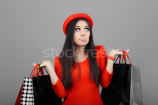 Undecided  Woman with Shopping Bags Stock photo © NicoletaIonescu