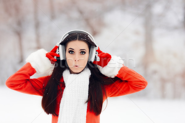 удивленный зима женщину беспроводных наушники возбужденный Сток-фото © NicoletaIonescu