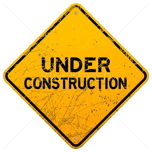 Dirty Under Construction Sign Stock photo © nikdoorg