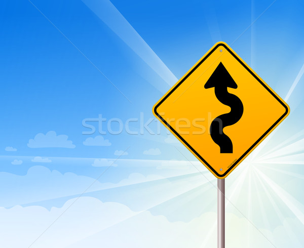 Stock photo: Winding road sign on blue sky