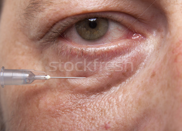 Man with syringe Stock photo © NikiLitov