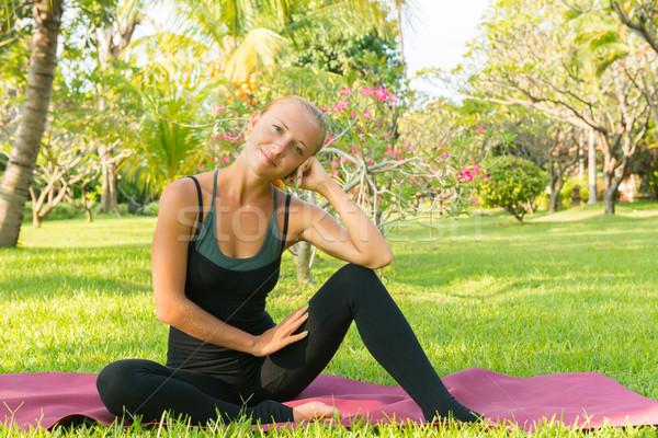 Woman doing yoga in garden Stock photo © nikitabuida