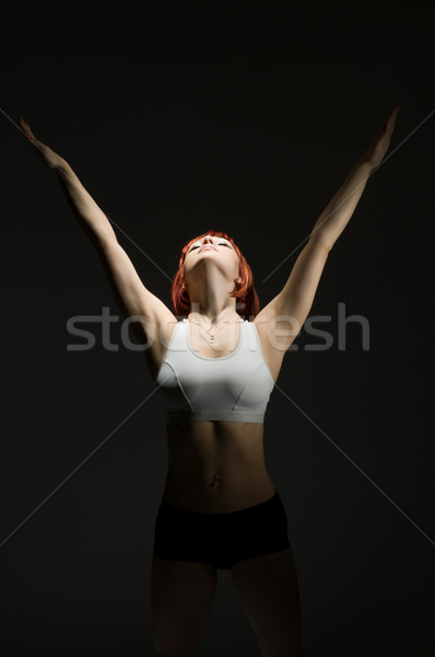 Beautiful fit red girl working out Stock photo © nikitabuida