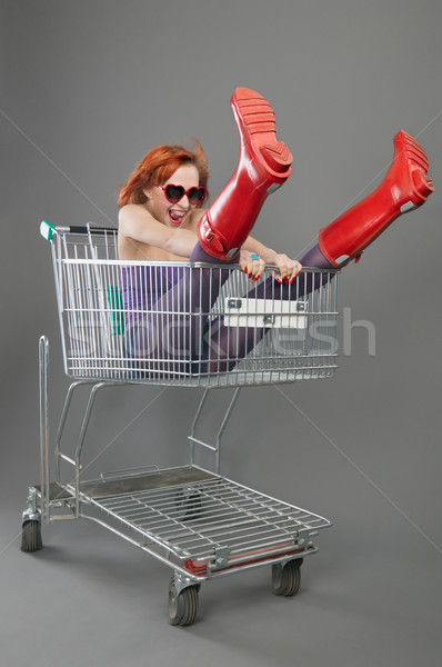 Red girl riding on a shopping cart Stock photo © nikitabuida