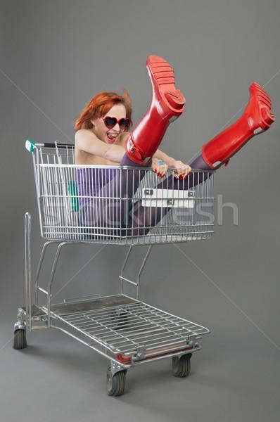 Piros lány lovaglás bevásárlókocsi gyönyörű izgatott Stock fotó © nikitabuida