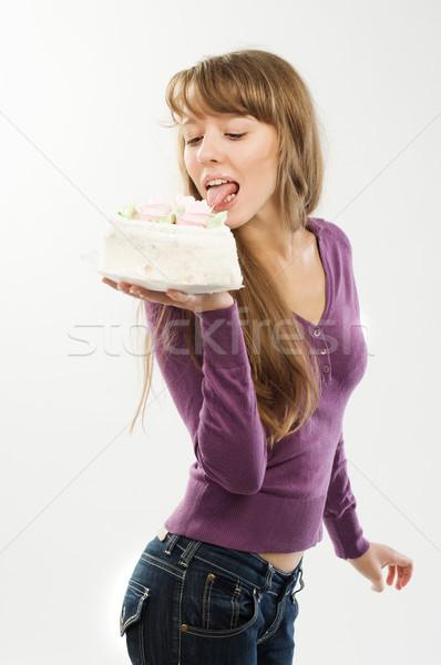 Beautiful girl licking candy Stock photo © nikitabuida