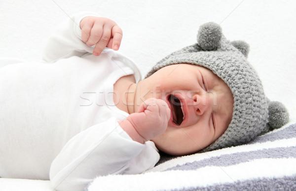 ребенка плачу мало кровать лице печально Сток-фото © nikkos