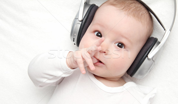 baby boy with headphone lies on back Stock photo © nikkos