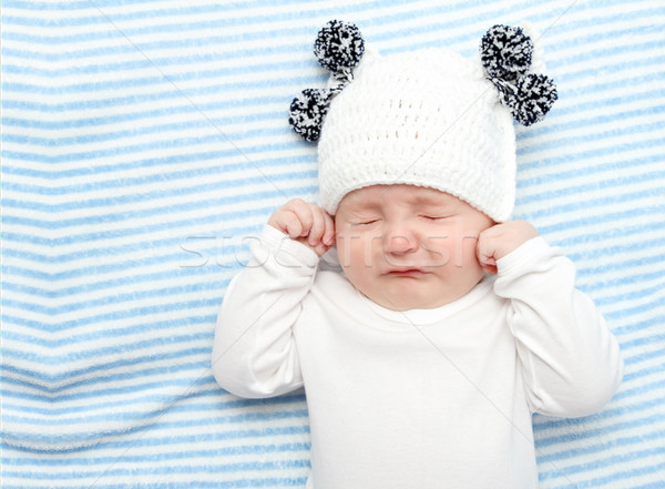 Bebé llorando pequeño cama cara triste Foto stock © nikkos