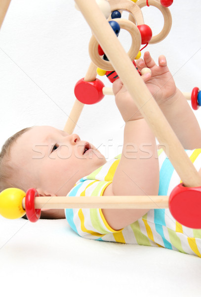 Сток-фото: ребенка · играет · игрушками · красивой · назад · лице