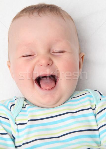 счастливым ребенка смеясь улыбка рот назад Сток-фото © nikkos