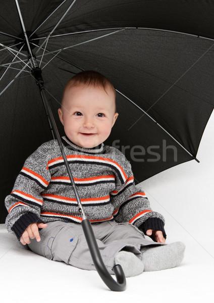 ребенка мальчика сидят зонтик улыбка лице Сток-фото © nikkos