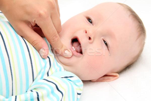 ребенка первый зубов улыбка матери мальчика Сток-фото © nikkos