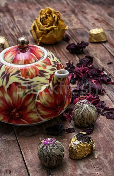 teapot in the background of elite sorts of tea Stock photo © nikolaydonetsk
