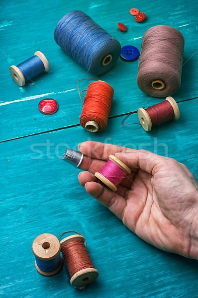 Dolgozik szerszám emberi kéz fonál gombok türkiz Stock fotó © nikolaydonetsk
