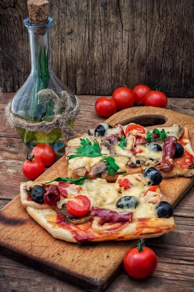 flavorful homemade pizza with bacon Stock photo © nikolaydonetsk