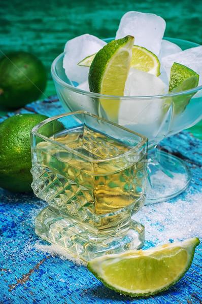 Koktél citrus egy üveg alkoholos ital gyümölcsök Stock fotó © nikolaydonetsk