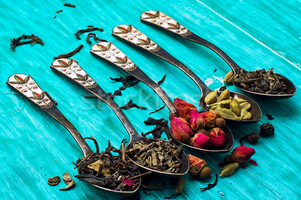 five varieties of loose tea tea spoons Stock photo © nikolaydonetsk