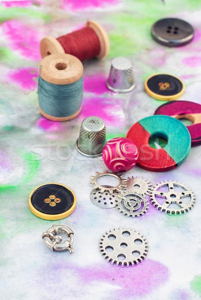Threads and embellishments on a colorful background Stock photo © nikolaydonetsk