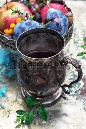 Chá medicinal ferro elegante caneca fruto Foto stock © nikolaydonetsk