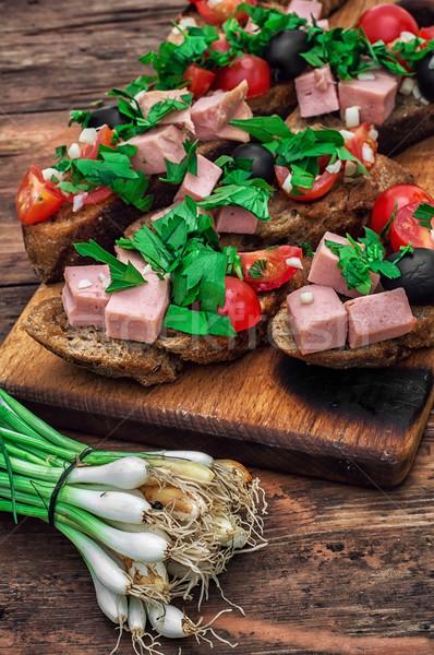 bruschetta with vegetables and meat Stock photo © nikolaydonetsk