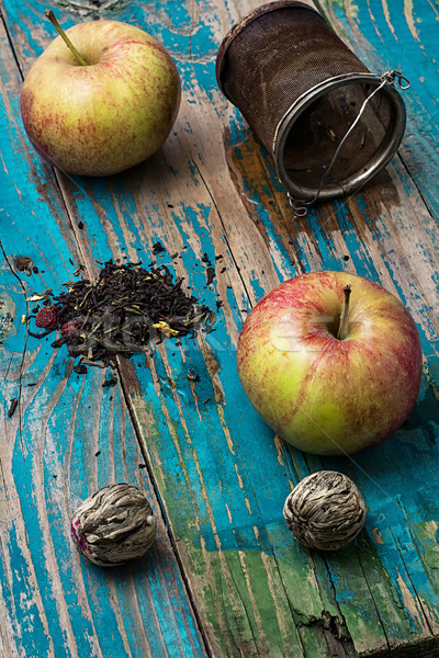 tea leaves and red apple on wooden background Stock photo © nikolaydonetsk