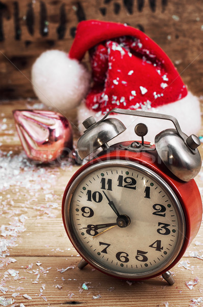 old-fashioned alarm clock and red Christmas cap Stock photo © nikolaydonetsk