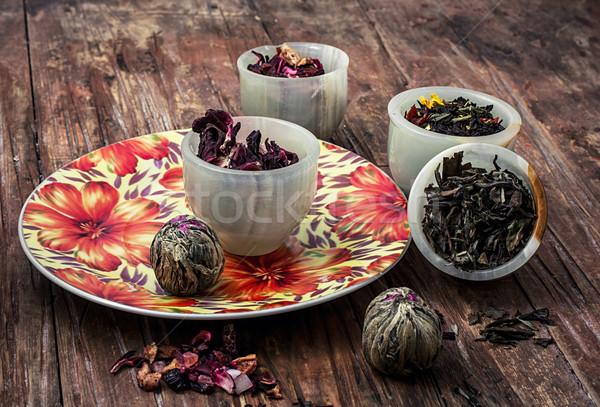 variety of dry tea leaves in jade stacks on wooden background Stock photo © nikolaydonetsk