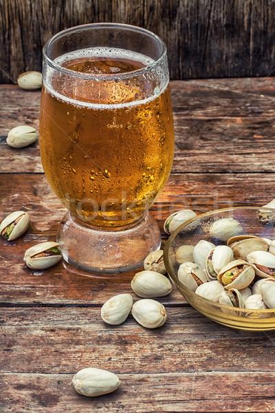 üveg világos sör sör fa asztal csészealj sózott Stock fotó © nikolaydonetsk