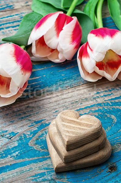 three hand-carved wooden heart with bouquet tulips Stock photo © nikolaydonetsk