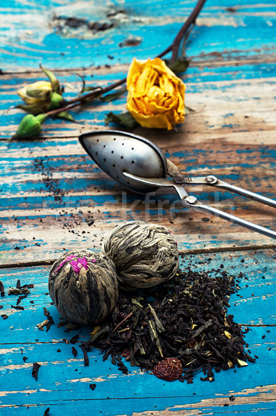 Tea leaves for brewing,tea spoon and dried yellow rose Stock photo © nikolaydonetsk
