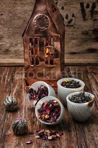 tea leaves on the background of the house foil  Stock photo © nikolaydonetsk