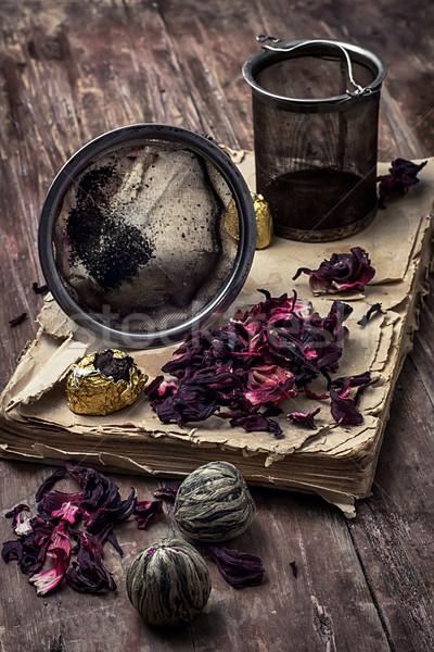 tea accessories amid frayed books Stock photo © nikolaydonetsk