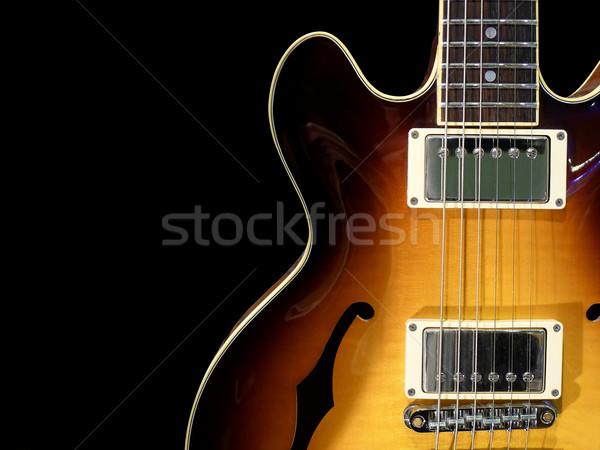 Klasszikus elektromos gitár közelkép elektromos dzsessz gitár Stock fotó © NiroDesign