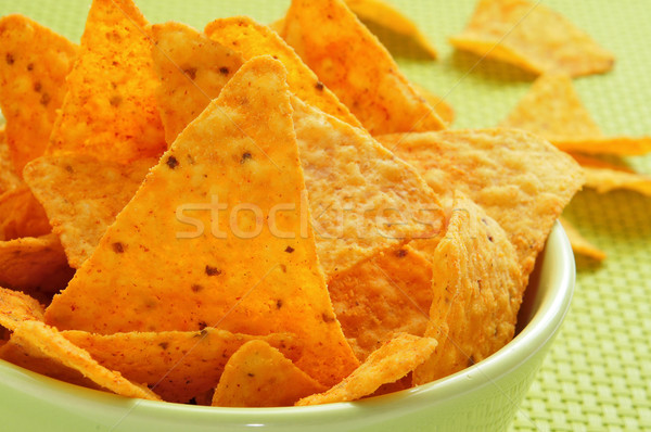 Nachos primer plano verde tazón servido alimentos Foto stock © nito