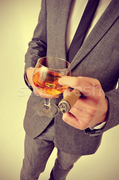 Homme costume cigare verre brandy Photo stock © nito