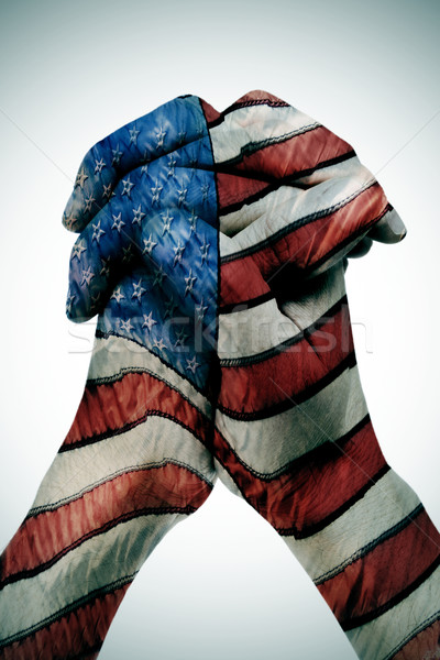 man clasped hands patterned with the american flag Stock photo © nito
