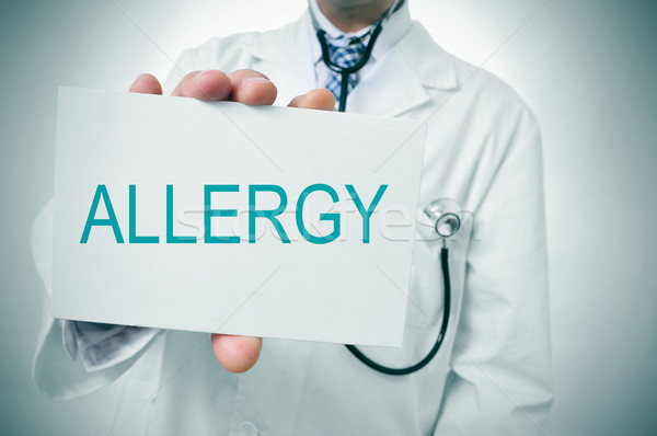 Stock photo: doctor showing a signboard with the word allergy