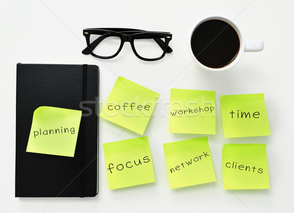 sticky notes with different work concepts on an office desk Stock photo © nito