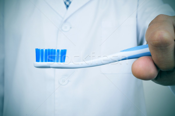 a dentist showing a toothbrush Stock photo © nito