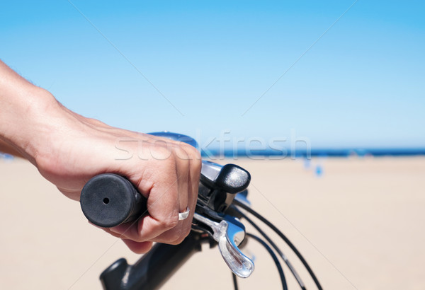 young man riding a bicycle by the ocean Stock photo © nito
