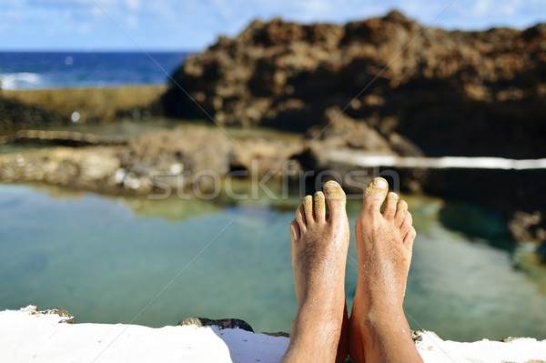 man relaxing in a natural pool of seawater Stock photo © nito